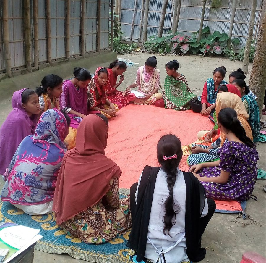 Bangladesh courtyard session: Girls in Bangladesh take part in a peer discussion.
