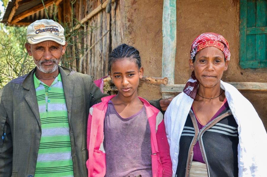 teenage girl with parents in Ethiopia