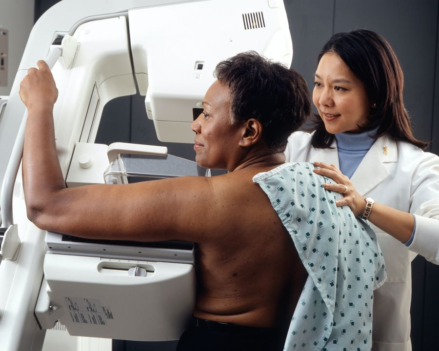 Black woman getting a mammogram
